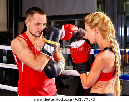 Couple Man and Woman Wearing Gloves Boxing in sport Ring. Martial art sport. - stock photo