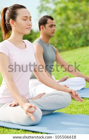 Couple meditating on fresh air - stock photo