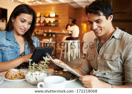 Couple Meeting In Busy Caf���© Restaurant - stock photo
