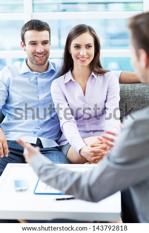 Couple meeting with financial adviser - stock photo