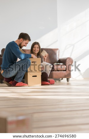Couple moving in house - mortgage concept - stock photo