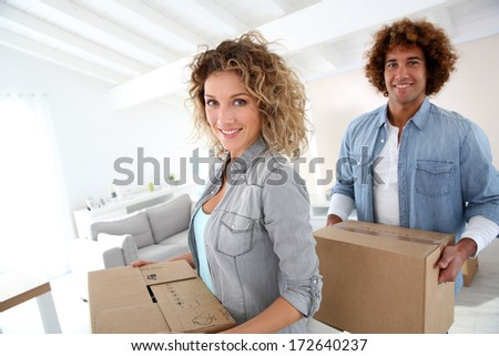 Couple moving in new apartment