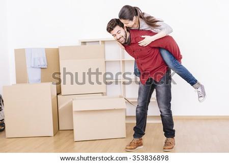 couple moving into empty new home so happy - stock photo