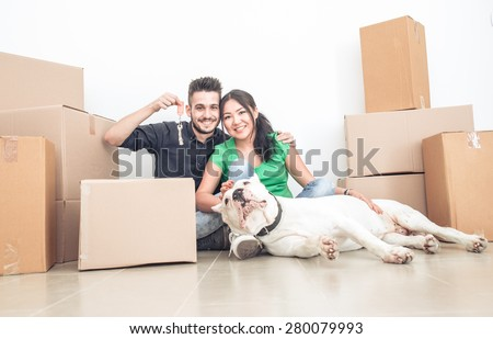 couple moving new home. concept about real estate, couples, relationships, and people