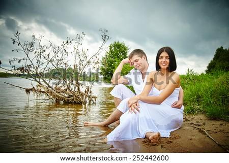 Couple near the water. Love. Beach. Kiss. Couple in love. - stock photo
