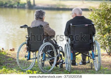 couple next to the lake - stock photo