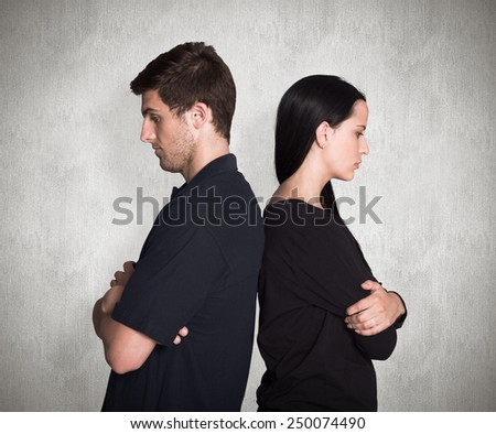 Couple not talking after argument against weathered surface - stock photo