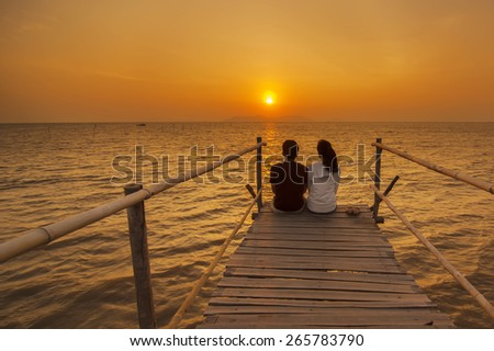 Couple observe sunrise at Can Gio, Ho Chi Minh City ( Saigon ), Vietnam - stock photo
