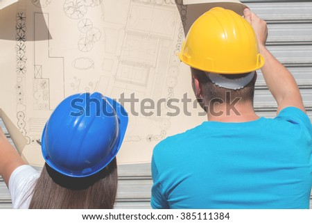 Couple observing plan and design. - stock photo