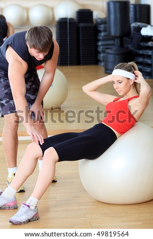 Couple of a sporty young people in the gym.
