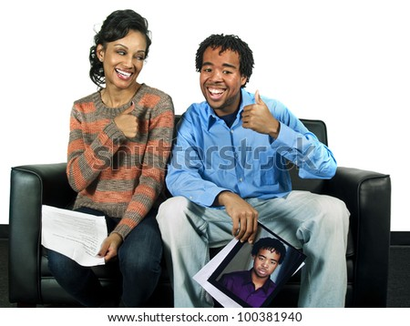 couple of actors holding a headshot and a script - stock photo