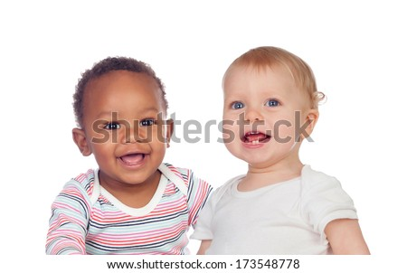 Couple of Babies African and Caucasian laughing on white background - stock photo