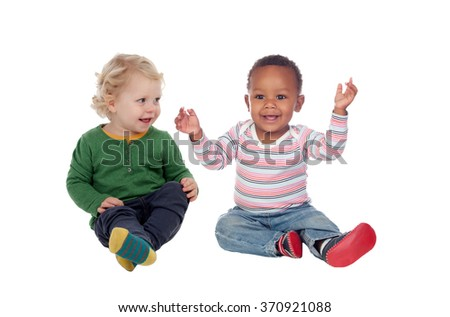 Couple of babies sitting on the floor isolated on a white background - stock photo