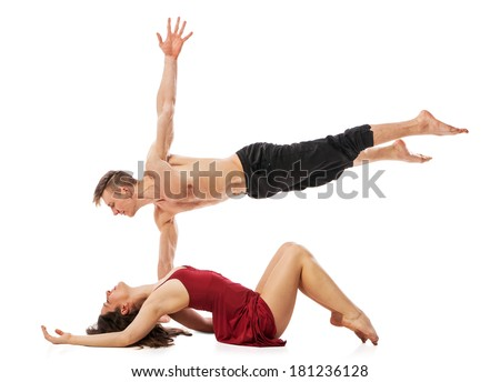 Couple of ballet dancers posing isolated over white background - stock photo