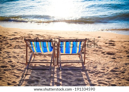 Couple of beach chairs on Pattaya beach in Thailand - stock photo