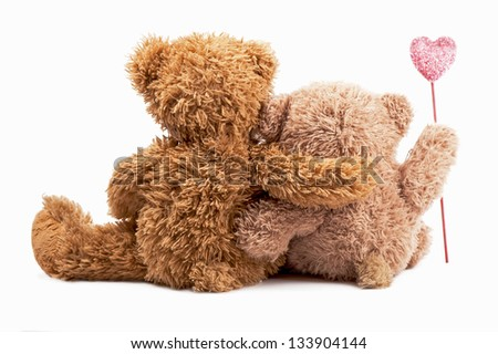 couple of bears embraced and hold heart - a love symbol