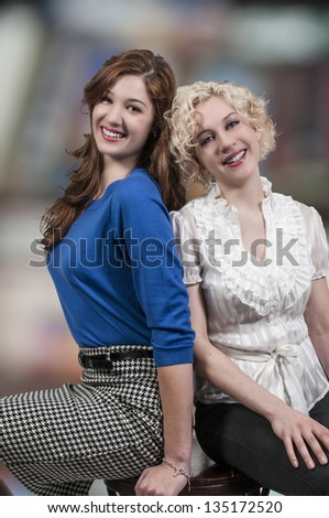 Couple of beautiful young women who are the best of friends - stock photo