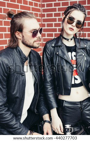 Couple of bikers in love. Outdoor lifestyle portrait