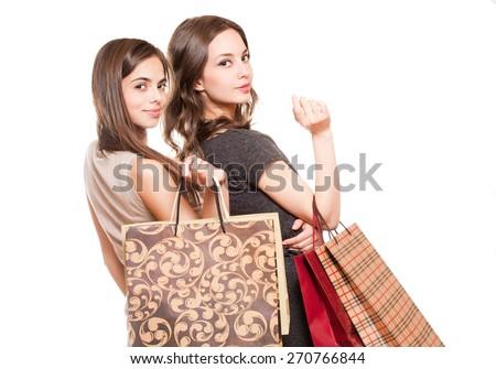 Couple of brunette beauties having shopping fun. - stock photo
