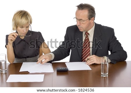 couple of businesspeople at the table - stock photo