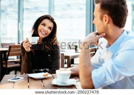 Couple of businesspeople enjoying a coffee together - stock photo