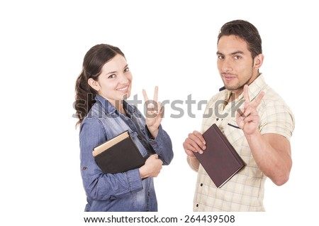 couple of cheerful happy attractive students holding book isolated on white - stock photo