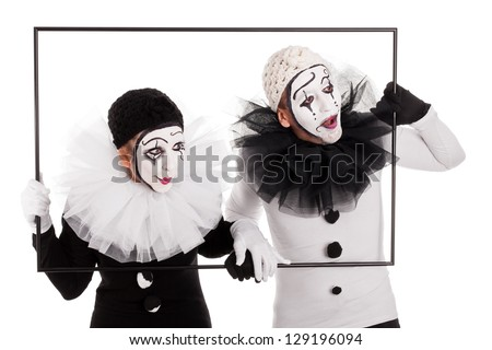 couple of clowns in a frame looking in the same direction - stock photo