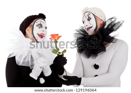 couple of clowns in love with a red flower - stock photo