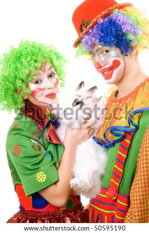 Couple of clowns with a white rabbit. Isolated - stock photo