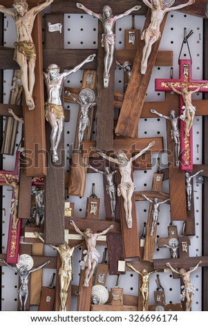 Couple of crosses for sale in a market place in Loreto, Italy - stock photo