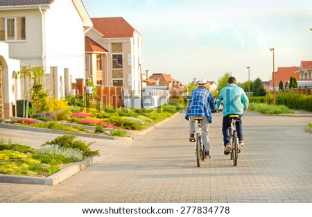 Couple of cyclists riding bicycles . - stock photo