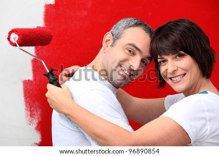 couple of diy painting it red - stock photo