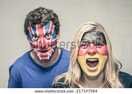 Couple of excited sports fans shouting. - stock photo