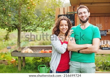 Couple of farmers in autumn - stock photo