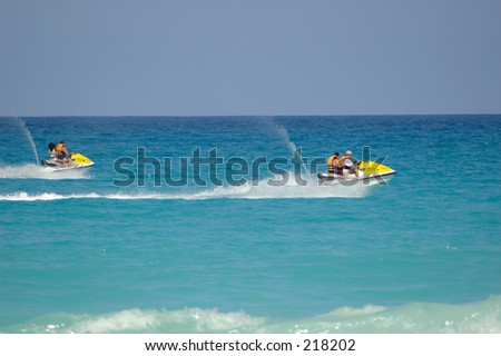 Couple of fast jetskis in the coasts of Cancun.