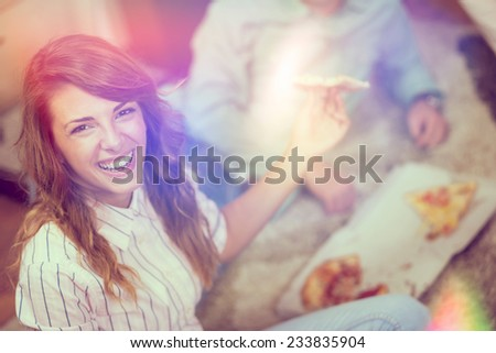 Couple of friends eating pizza and having fun - stock photo