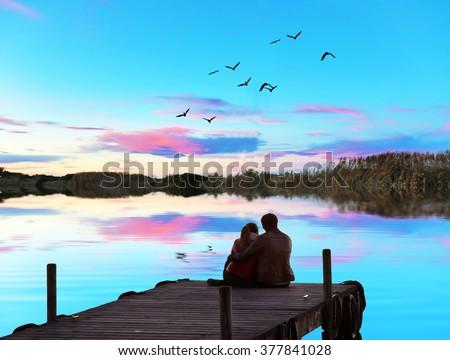 couple of friends enjoying the sunset - stock photo