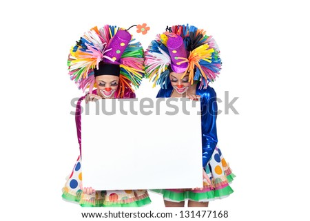 Couple of funny clowns with a blank poster isolated on white background - stock photo