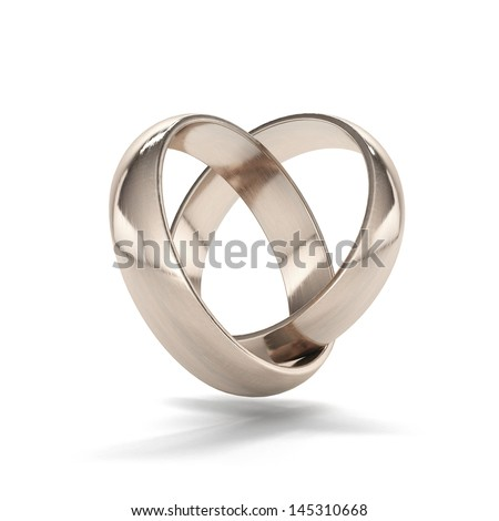 couple of gold wedding rings in heart shape - stock photo