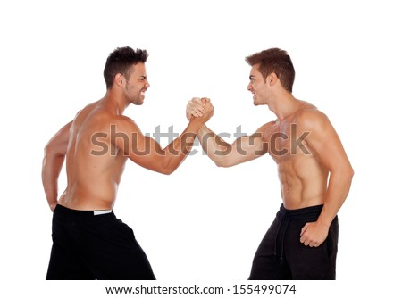Couple of handsome muscled men competing isolated on a white background - stock photo