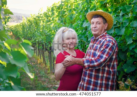 Couple of  happy people on a romantic date in the vineyard