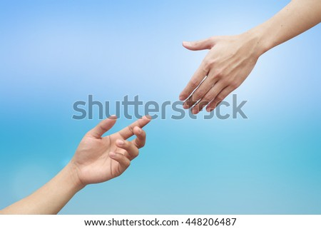 couple of helping/praying hand on blurred colorful blue gradient background,support/aid/love/trust concept.healthcare/therapy/healing conceptual ideal.kindness/compassion/affection:friends and family.