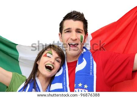 Couple of Italian football supporters - stock photo