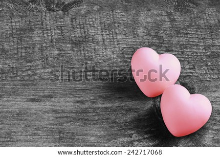 Couple of love pink hearts on wooden dark background - valentines - mothers day - fathers day - wedding invitation - card - space for text - stock photo