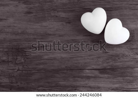 Couple of love white hearts on wooden dark background - valentines - mothers day - fathers day - wedding invitation - card - space for text - stock photo