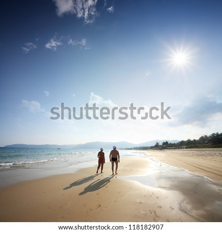 couple of lover walking on beach