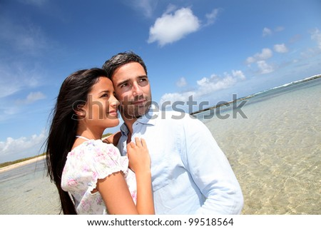 Couple of lovers embracing each other at the beach