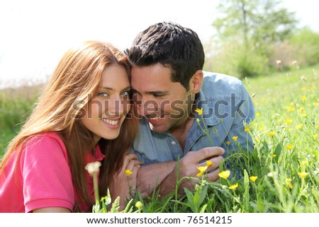 Couple of lovers laying donw in park - stock photo