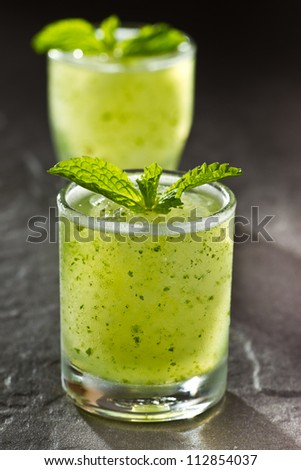 Couple of Mojito, a kind of cocktail drink on stone background