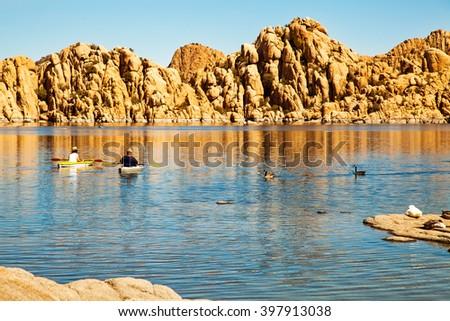 Couple of people rowing boats on scenic Watson Lake, Arizona - stock photo